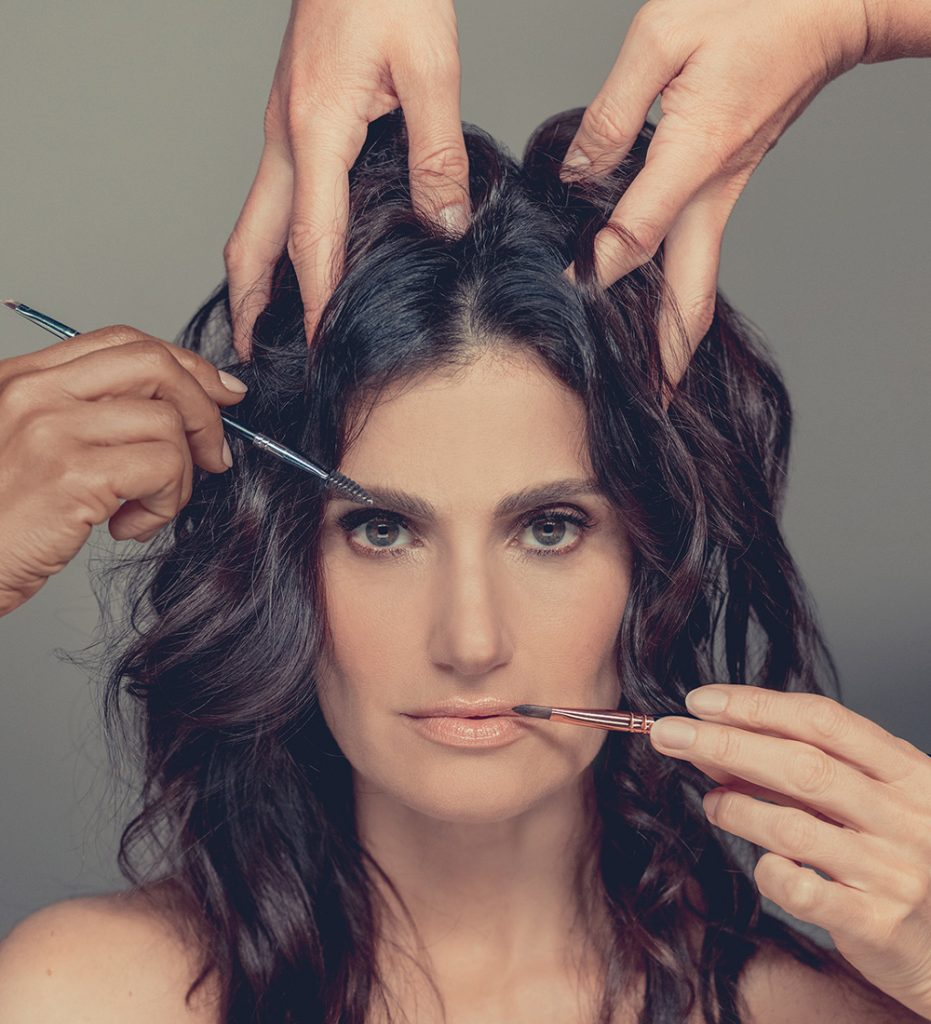 Photo of Idina Menzel having her hair and makeup done for Skintight's marketing campaign