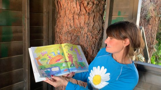 Idina Menzel reading a storybook