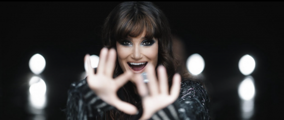 """Idina Menzel performing in the """"Dream Girl"""" music video"""